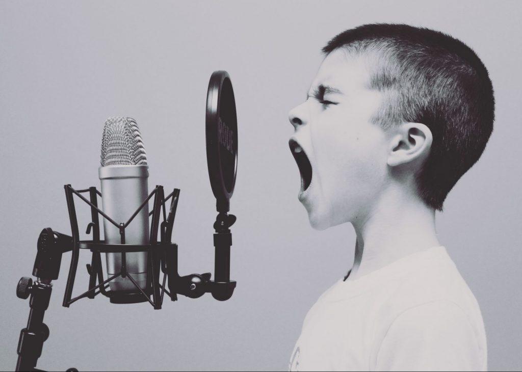 Boy talking in Microphone